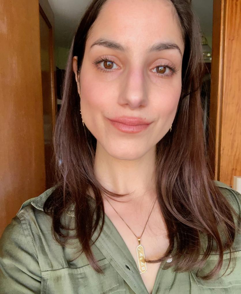 Woman with dark brown hair and brown eyes/ Farah J Fard